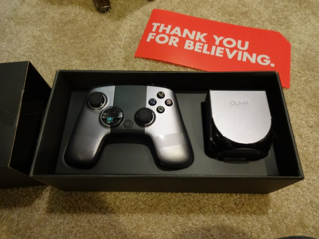 "Very neatly packed in their slide box of sweetness.  I still think it's neat how they listened to their Kickstarter people and changed the button symbols to ""OUYA""."