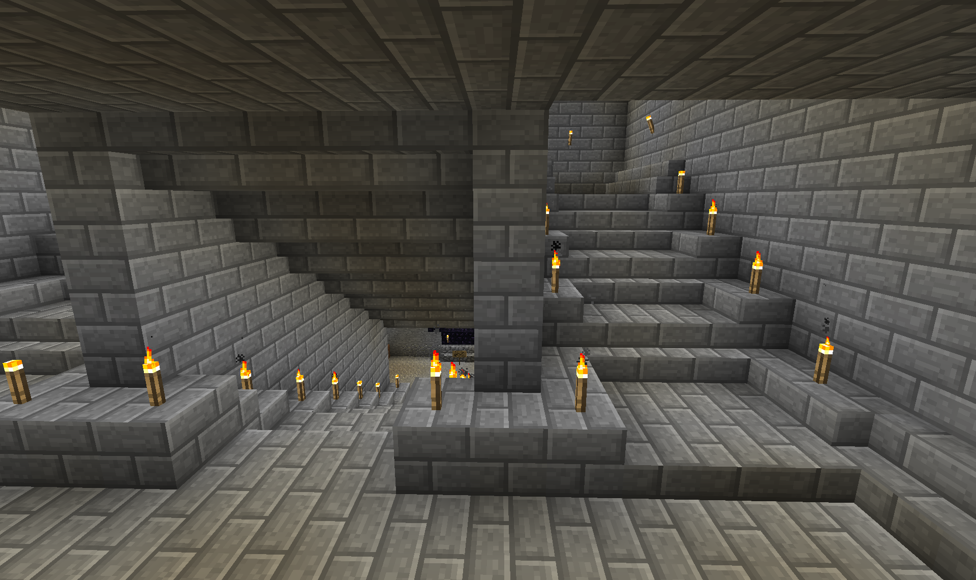 The stairs converge again and then go down into the room where my nether portal will reside. I'm really liking how the stairs turned out.